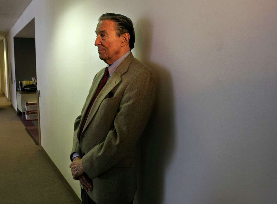 "This May 8, 2006 file photo shows Mike Wallace, veteran CBS "" 60 Minutes"" correspondent, waiting in a hallway near his office to see a colleague in New York, Monday May 8, 2006. Wallace, famed for his tough interviews on ""60 Minutes,"" has died, Saturday, April 7, 2012. He was 93.  (AP Photo/Bebeto Matthews) Photo: BEBETO MATTHEWS, Associated Press / AP2006"