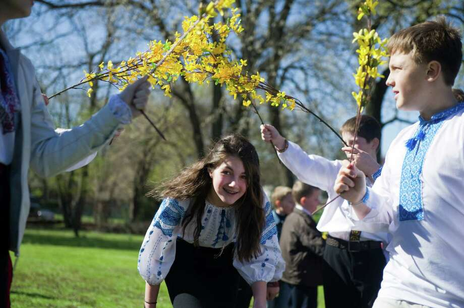 """Emily Lencyk and other children of the School of Ukrainian Studies celebrate Easter Sunday with a performance of """"Hailky-Vesnianky"""" outside St. Volodymyr's Ukrainian Catholic Cathedral in Stamford, Conn., April 8, 2012. In pre-Christian times, Hailky were believed to have the magical power of enticing spring. The songs and dances are drawn from nature and are believed to bring luck and wealth. Photo: Keelin Daly / Stamford Advocate"""