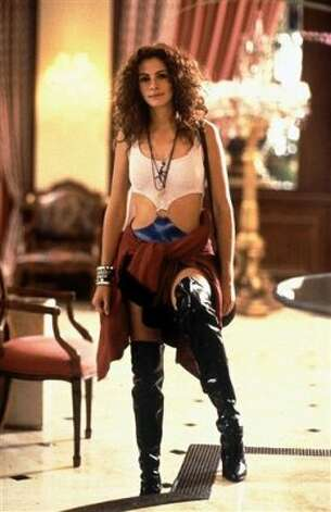 "We give ""Pretty Woman"" the ""best fashion transformation"" award. Julia Roberts looks amazing in those sky-high leather boots, but we love her decked out in the red gown and white gloves that come later. (AP)"