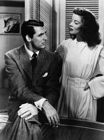 "Katharine Hepburn's best film fashion? It's so hard to choose. We particularly love her bold but feminine style in ""Philadelphia Story"" (seen here) and over-the-top elegance in ""Bringing up Baby."" (MGM 1940)"