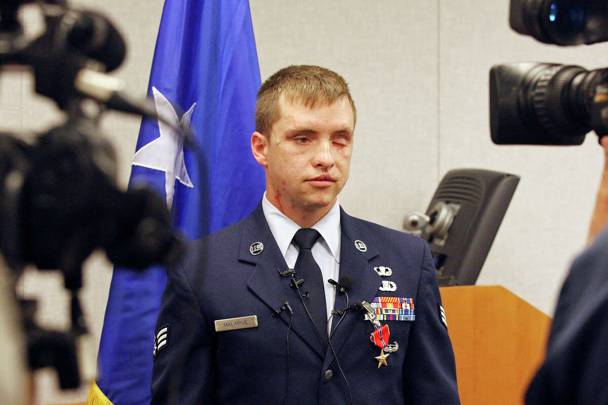 Senior Airman Michael Malarsie, a former Air Force Joint Attack Controller, answers questions from the media after being award the Bronze Star with