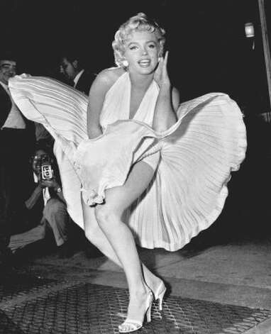 "Like Katharine Hepburn, Marilyn Monroe never hit the big screen without looking sensational, but her white dress in ""The Seven Year Itch"" might be the single most iconic fashion piece in film's history. (20th Century Fox 1955 / AP)"