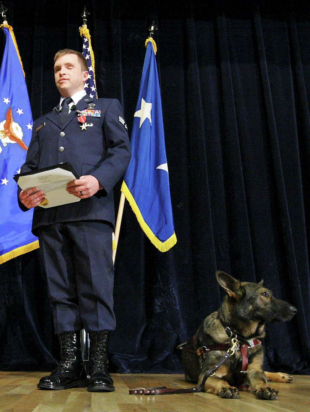 Maj. Gen. Byron Hepburn, commander of the 59th Medical Wing, Director San Antonio Military Health System, (from left) applauds after awarding Senior Airman Michael Malarsie, a former Air Force Joint Attack Controller, the Bronze Star with