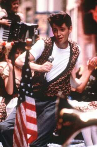 "Between Ferris' leopard print vest, Cameron's Red Wings jersey and Sloane's fringed leather jacket, the fashion in ""Ferris Bueller's Day Off"" is as fun and memorable as the film itself. (AP)"