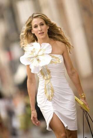 "Love it or hate it, Carrie Bradshaw's style is all her own. Her wedding dress in the first ""Sex and the City"" movie, designed by Vivienne Westwood (not pictured here), sold out in less than a day. (Craig Blankenhorn / AP)"