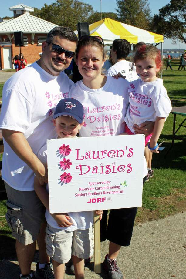 The Santora family is depicted here at the Juvenile Diabetes Research Foundation walk in October of 2011 at Calf Pasture Beach in Norwalk. They organized a team of more than 45 people called Lauren's Daisies. Photo: Contributed Photo