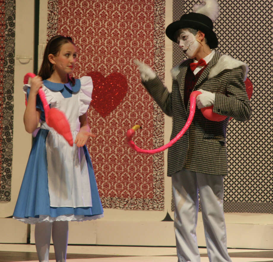 """Simone Barr as Alice and and Tyler Miller as the White Rabbit were among more than 100 students who participated in Bedford Middle School's production of """"Alice in Wonderland."""" The show featured eight different actresses in the role of Alice, accounting for her shrinking and growing.. Photo: Contributed Photo / Westport News contributed"""