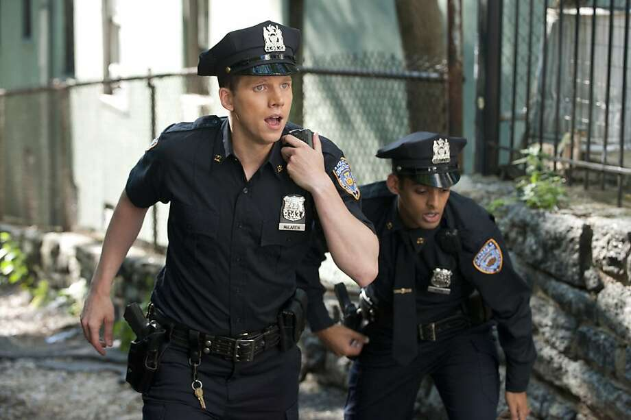 """Playing God""-- Tom Reed (left) as Afghani native Ahmad Khan and Stark Sands (right) as fourth-generation cop Kenny McLaren, part of a group of six NYPD rookies tasked with patrolling the gritty streets of Harlem, on the series premiere of NYC 22, Sunday, April 15. Photo: David Giesbrecht, CBS ENTERTAINMENT"