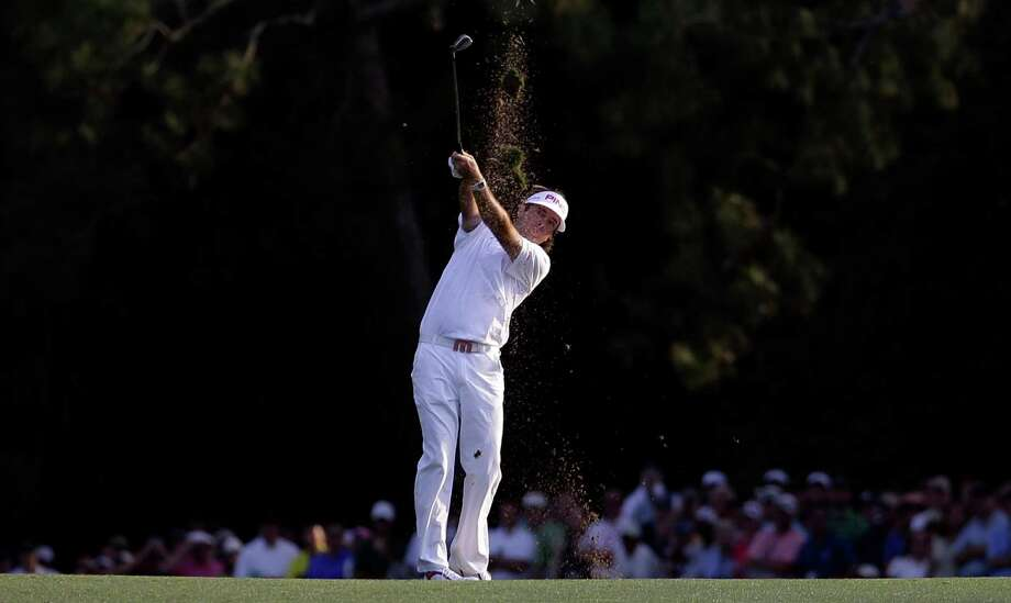 Bubba Watson hits off the 18th fairway during the fourth round of the Masters golf tournament Sunday, April 8, 2012, in Augusta, Ga. (AP Photo/David J. Phillip) Photo: David J. Phillip, Associated Press / AP