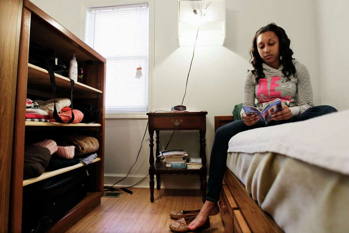 Chenae Perkins reads in a transitional home for female veterans in Nashville, Tenn. After returning from deployment to Iraq with her National Guard unit, Perkins has struggled to find steady work.