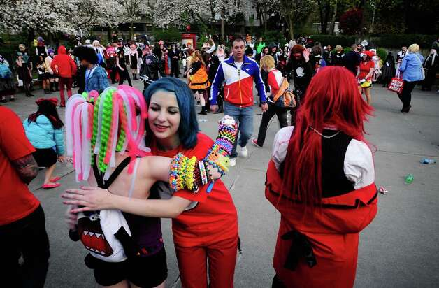 Characters hug each other during the 15th annual Sakura-Con  in the Washington State Convention Center on Saturday. Photo: LINDSEY WASSON / SEATTLEPI.COM