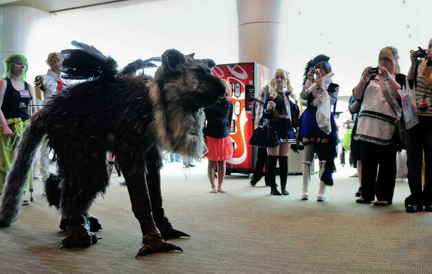 Amanda Nadler poses for photos in her griffin costume from the video game The Last Guardian. Photo: LINDSEY WASSON / SEATTLEPI.COM