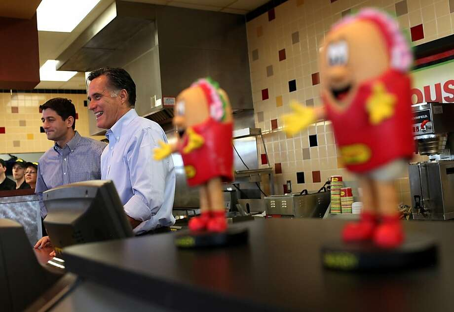 WAUKESHA, WI - APRIL 03:  Republican Presidential candidate, former Massachusetts Gov. Mitt Romney (R) and U.S. Rep Paul Ryan (L) (R-WI) hand out sandwiches to supporters at Cousins Subs on April 3, 2012 in Waukesha, Wisconsin. Mitt Romney makes one more appeal to voters on primary day in Wisconsin.  (Photo by Justin Sullivan/Getty Images) Photo: Justin Sullivan, Getty Images