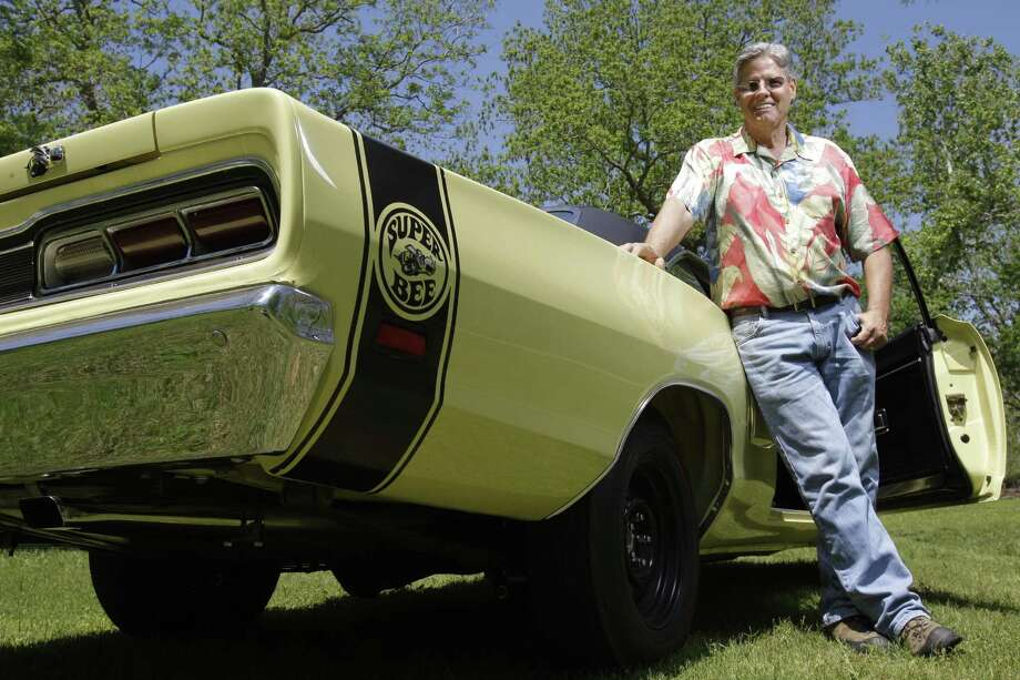 John Hovas of Brookshire will be taking this 1969 Dodge Super Bee to sell at Mecum Auto Auction - the first ever in Houston - at Reliant Center on Friday and Saturday. Semi-retired, Hovas says he and his wife go to Mecum auctions all over the country. Photo: Melissa Phillip / © 2012 Houston Chronicle