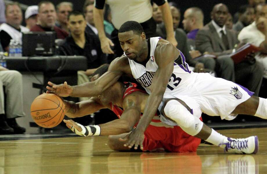 Houston Rockets center Marcus Camby, left, and Sacramento Kings guard Tyreke Evans dive for the ball during the first quarter of an NBA basketball game in Sacramento, Calif., Sunday, April 8, 2012.(AP Photo/Rich Pedroncelli) Photo: Rich Pedroncelli, Associated Press / AP