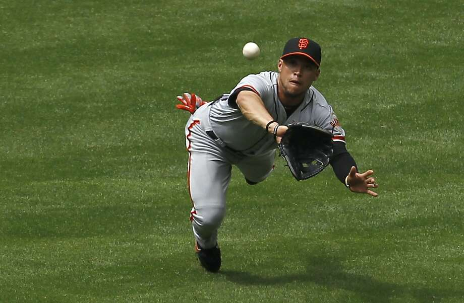 San Francisco Giants' Gregor Blanco makes a diving catch on a line drive by Arizona Diamondbacks' Ryan Roberts during the fourth inning in an MLB baseball game Sunday, April 8, 2012, in Phoenix. Photo: Ross D. Franklin, Associated Press