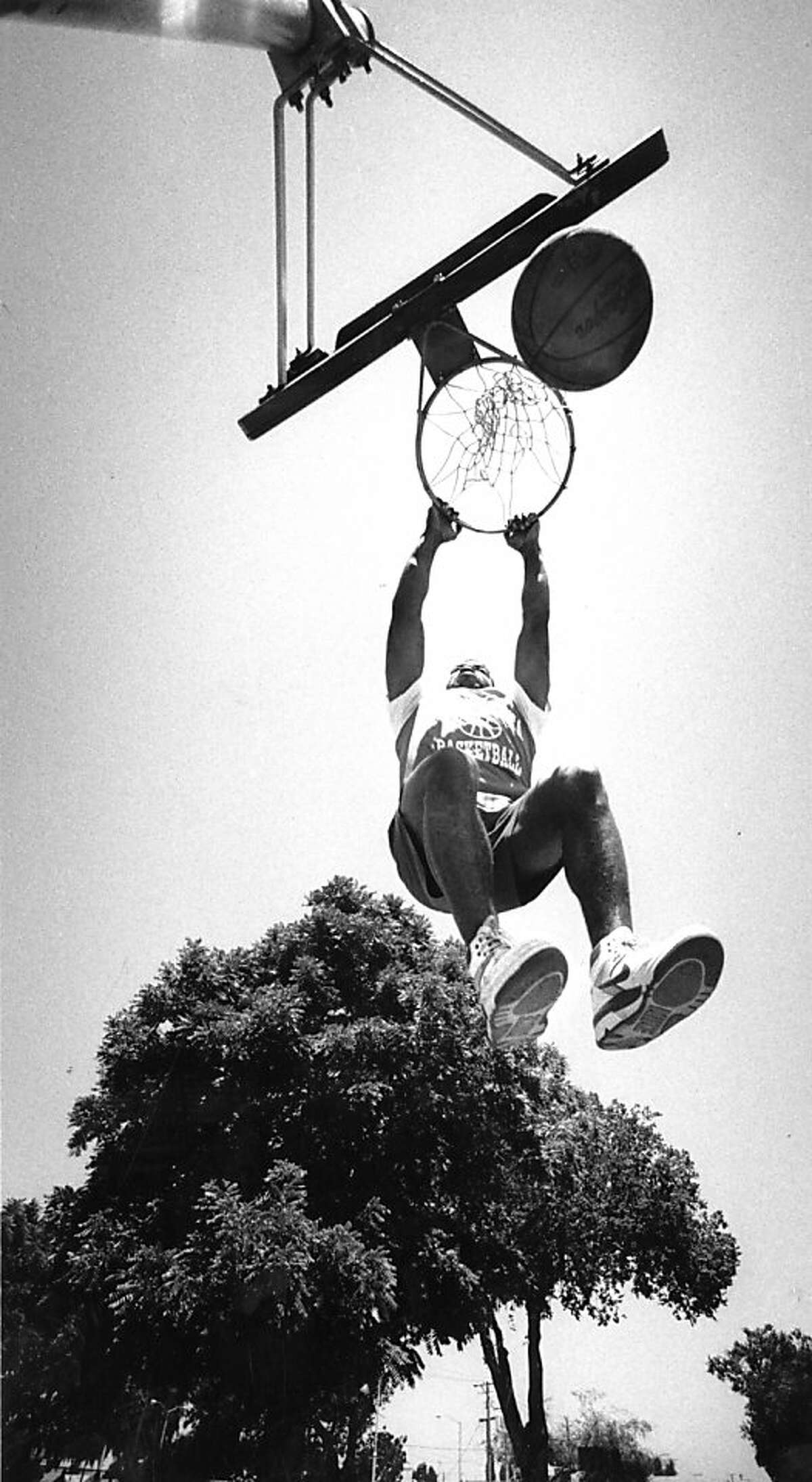 """Demetrius """"Hook"""" Mitchell dunks at Mosswood Park in Oakland. July 6, 1989."""