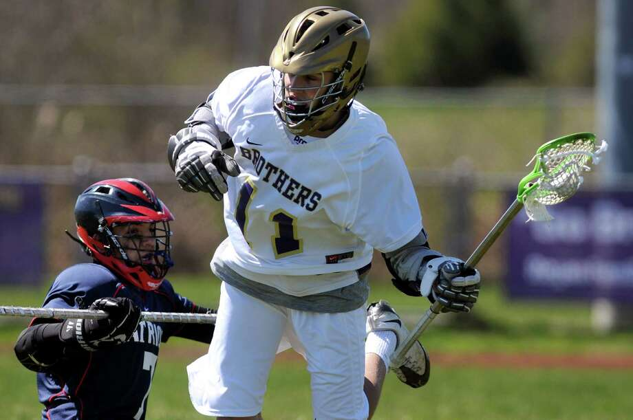 CBA's Noah Arciero (11), right, looks to pass as Schenectady's Erick Campos (7) defends during their lacrosse game on Saturday, April 7, 2012, at Christian Brothers Academy in Colonie, N.Y. (Cindy Schultz / Times Union) Photo: Cindy Schultz / 00017053A