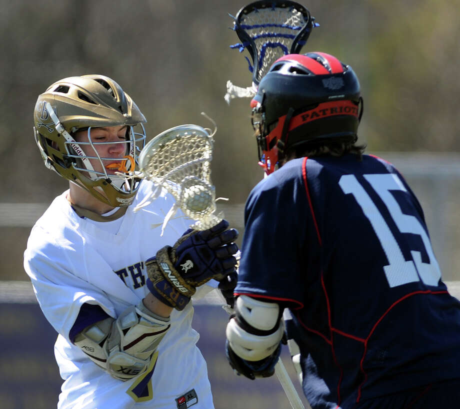 CBA's Aidan Murphy (27), left, fights to keep the ball as Schenectady's Ryan Bidwell (15) defends during their lacrosse game on Saturday, April 7, 2012, at Christian Brothers Academy in Colonie, N.Y. (Cindy Schultz / Times Union) Photo: Cindy Schultz / 00017053A