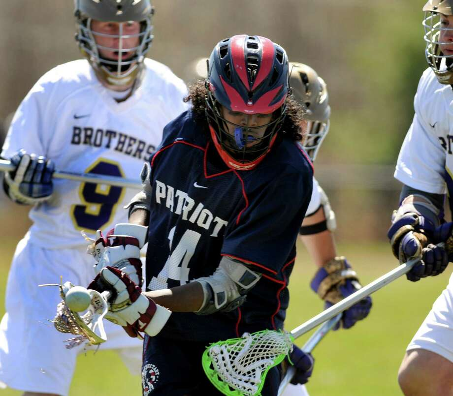 Schenectady's Jordan Zaman (14) loses control of the ball during their lacrosse game against CBA on Saturday, April 7, 2012, at Christian Brothers Academy in Colonie, N.Y. (Cindy Schultz / Times Union) Photo: Cindy Schultz / 00017053A