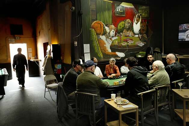 A card table is filled with players as poker is played at Pete's 881 Club,on Friday April 6, 2012, in San Rafael, Ca. A California State bill is looking at legislation that would legalize online/ internet poker and perhaps other games in the future. Cards rooms like Pete's would be allowed to get a license to offer online gaming under the current draft of legislation. Photo: Michael Macor, The Chronicle