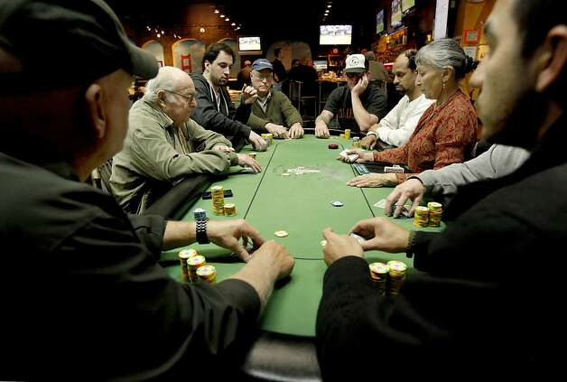 The card tables filled as poker  is played at Pete's 881 Club, on Friday April 6, 2012, in San Rafael, Ca. A California State bill is looking at legislation that would legalize online/internet poker and perhaps other games in the future. Cards rooms like Pete's would be allowed to get a license to offer online gaming under the current draft of legislation. Photo: Michael Macor, The Chronicle