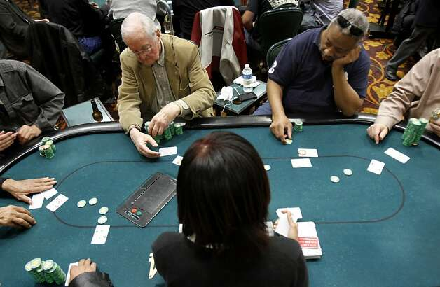 Jim Walls, right, of Oakland, and Albert Rubey, left, of Alamo, play poker at the Oaks Card Club in Emeryville, Calif., Friday, April 6, 2012.  A proposed state bill would legalize online poker and perhaps other games in the future. Card clubs like Oaks would be allowed to get a license to offer online gaming under the current draft of the legislation. Photo: Sarah Rice, Special To The Chronicle