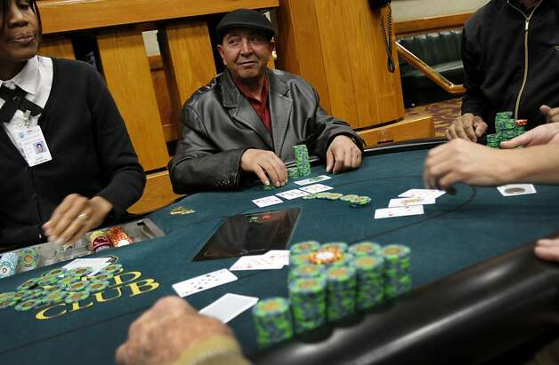 Toufike Abdo, of Oakland, plays poker at the Oaks Card Club in Emeryville, Calif., Friday, April 6, 2012.  A proposed state bill would legalize online poker and perhaps other games in the future. Card clubs like Oaks would be allowed to get a license to offer online gaming under the current draft of the legislation. Photo: Sarah Rice, Special To The Chronicle
