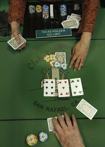 A dealer runs the table as a poker game is played at Pete's 881 Club, on Friday April 6, 2012, in San Rafael, Ca. A California State bill is looking at legislation that would legalize online/internet poker and perhaps other games in the future. Cards rooms like Pete's would be allowed to get a license to offer online gaming under the current draft of legislation. Photo: Michael Macor, The Chronicle