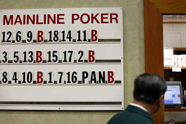 The poker board at the Oaks Card Club in Emeryville, Calif., Friday, April 6, 2012.  A proposed state bill would legalize online poker and perhaps other games in the future. Card clubs like Oaks would be allowed to get a license to offer online gaming under the current draft of the legislation. Photo: Sarah Rice, Special To The Chronicle