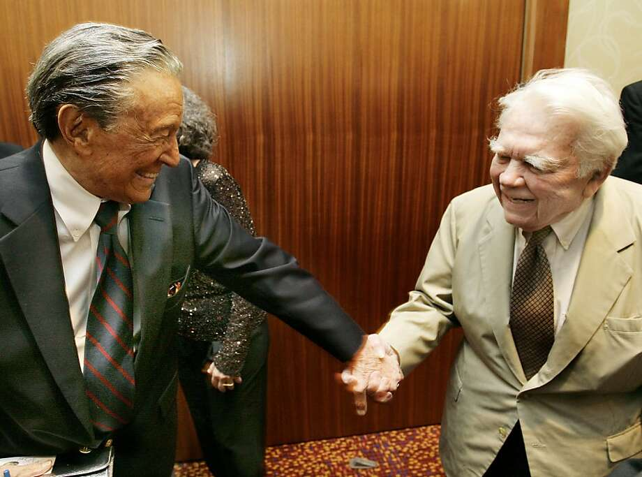 """This May 12, 2007 photo released by CN8 cable network, CBS' 60 Minutes' Mike Wallace, left, greets colleague Andy Rooney during a reception at the 30th annual Boston/New England Emmy Awards in Boston. Wallace, famed for his tough interviews on """"60 Minutes,"""" has died, Saturday, April 7, 2012. He was 93. (AP Photo/CN8, Michael Dwyer) NO SALES Photo: Michael Dwyer, Associated Press"""