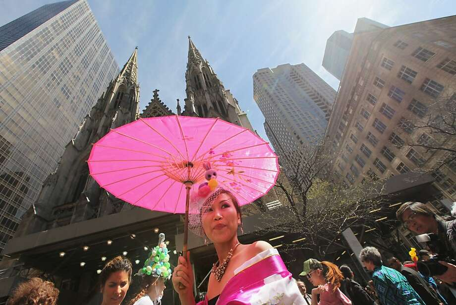 NEW YORK, NY - APRIL 08:  Natalie Le stands in her holiday finery in front of St. Patrick's Cathedral along Fifth Avenue during the annual Easter Parade April 8, 2012 in New York City. The parade is a New York tradition dating back to the mid-1800s when the social elite would parade their new fashions down Fifth Avenue after attending Easter services in one of the Fifth Avenue churches.   (Photo by Mario Tama/Getty Images) Photo: Mario Tama, Getty Images