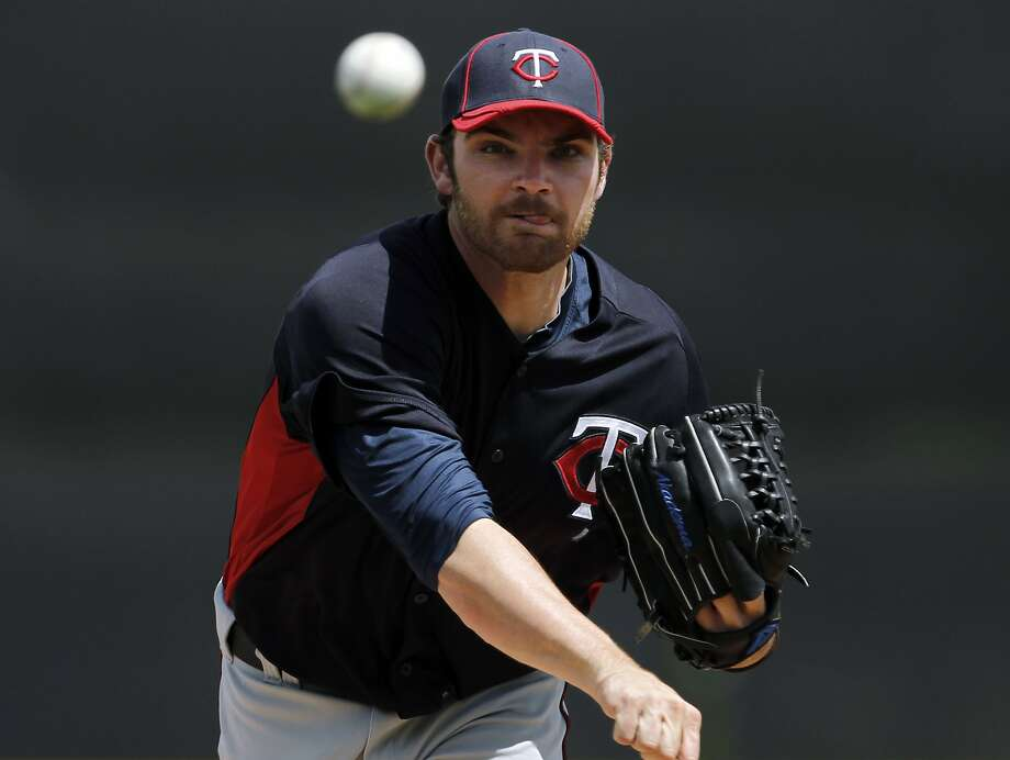 Minnesota Twins starting pitcher Liam Hendriks warms up before a spring training baseball game in Lakeland, Fla., Wednesday, March 21, 2012. (AP Photo/Paul Sancya) Photo: Paul Sancya, Associated Press