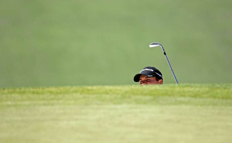 Sean O'Hair watches his shot out of a bunker on the second hole during the fourth round of the Masters golf tournament Sunday, April 8, 2012, in Augusta, Ga. Photo: Matt Slocum