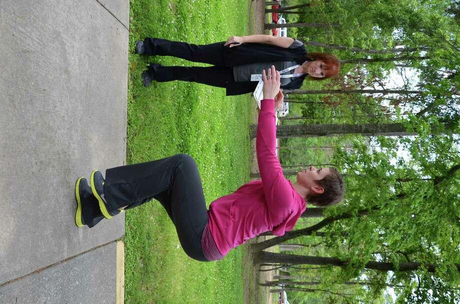 Peggy Thibodaux does a gait analysis on YMCA staffer Michelle Hill.