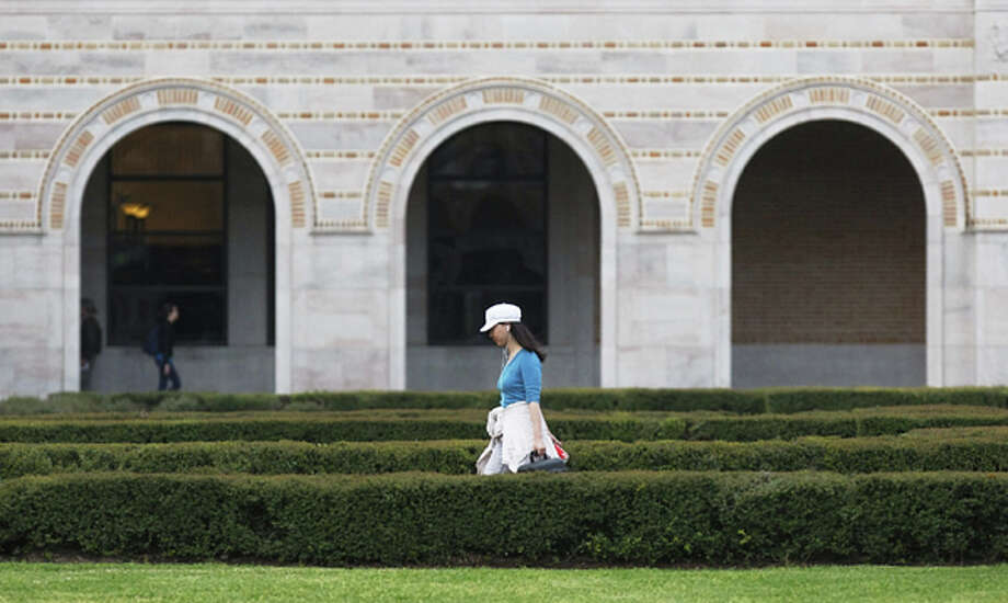 Celine Zhou, a junior architecture major at Rice University walks the campus quad Thursday, March 8, 2012. (Houston Chronicle)