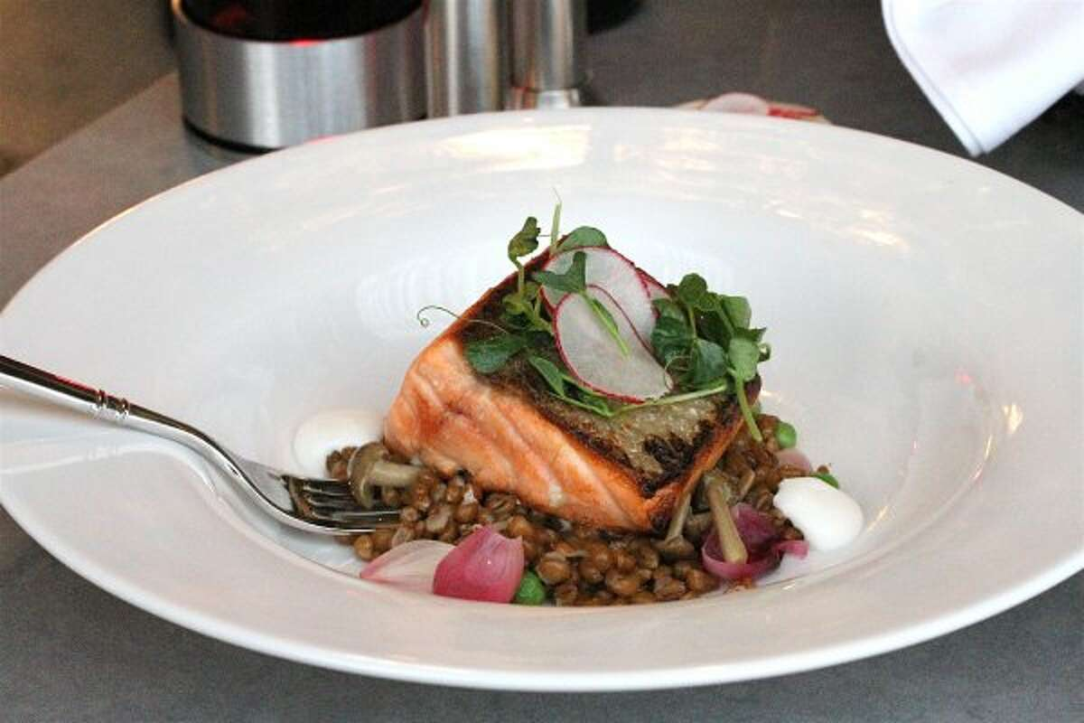 Pan seared Scottish Salmon served with wheat berry risotto, English peas, morels, pickled red pearl onions, and chervil lemon crème fraiche (Richard Femenella)