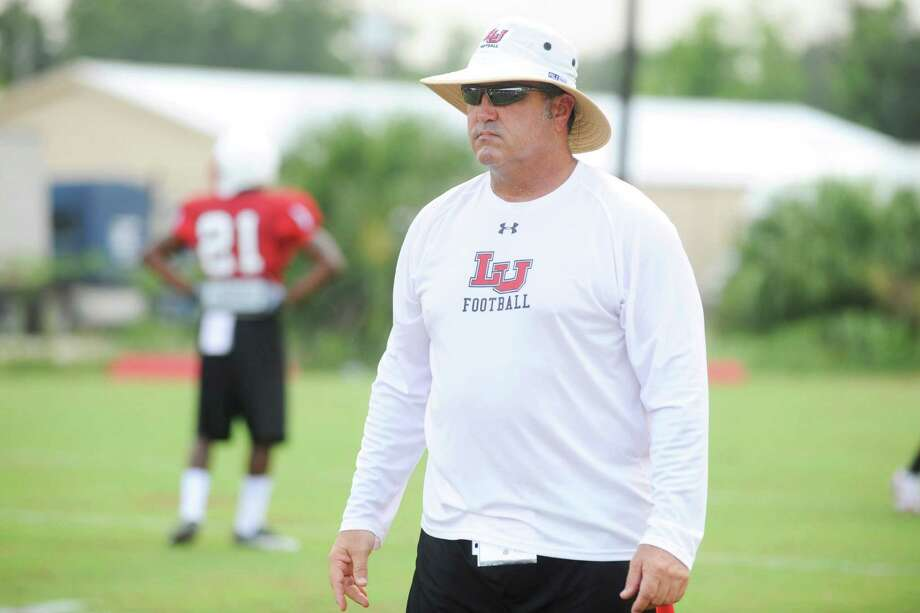Lamar linebacker coach Craig McGallion works with Cardinal linebackers during practice on Tuesday at Vernon Glass Field of Champions.  Tuesday, August 24, 2010 Valentino Mauricio/The Enterprise Photo: Valentino Mauricio / Beaumont