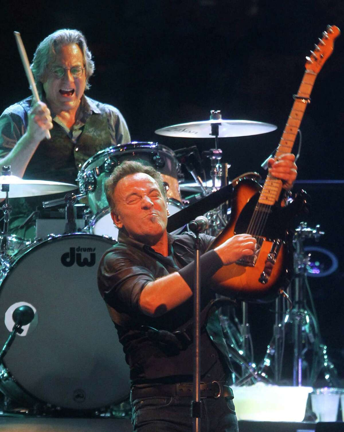 Bruce Springsteen performs with E Street Band member Max Weinberg, drums, during a concert at Madison Square Garden, Friday, April 6, 2012 in New York.