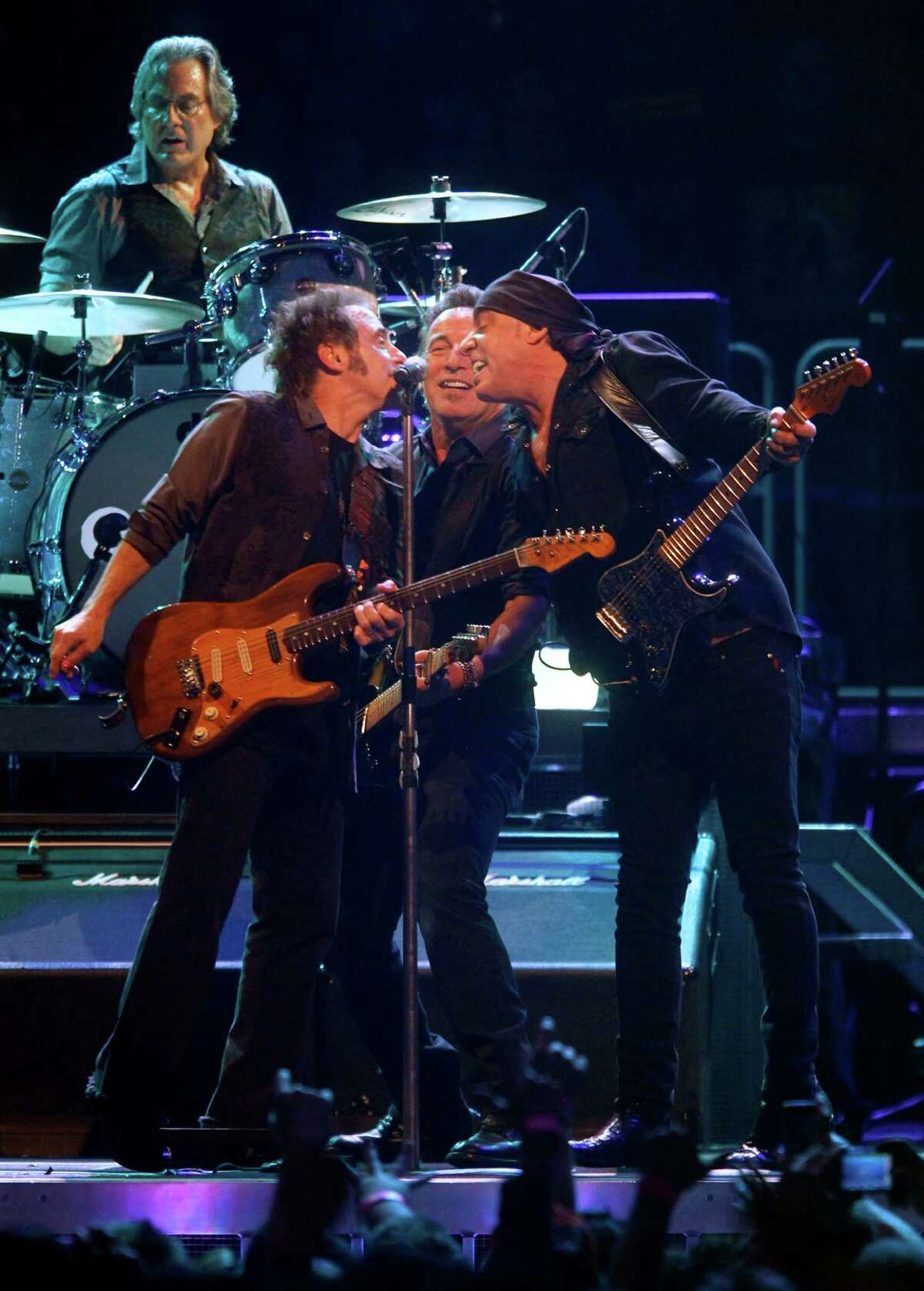 Bruce Springsteen, center, performs with E Street Band members Max Weinberg, drums, Nils Lofgren, left, and Steven Van Zandt, right, during a concert at Madison Square Garden, Friday, April 6, 2012 in New York.