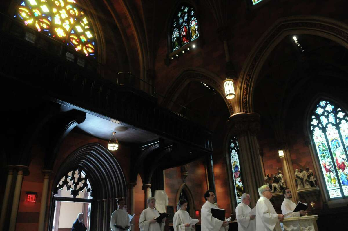Members of the choir line up to walk in to the cathedral during Easter mass at the Cathedral of the Immaculate Conception on Sunday, April 8, 2012 in Albany, NY. (Paul Buckowski / Times Union)