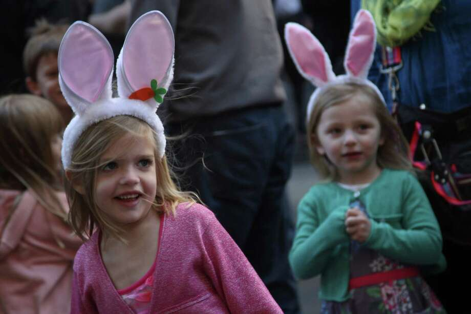 Emily Radke, 6, left, reacts as she is entertained by a puppeteer during the Easter Parade on Fifth Ave.,  Sunday, April 8, 2012 in New York. Photo: Mary Altaffer, AP / AP