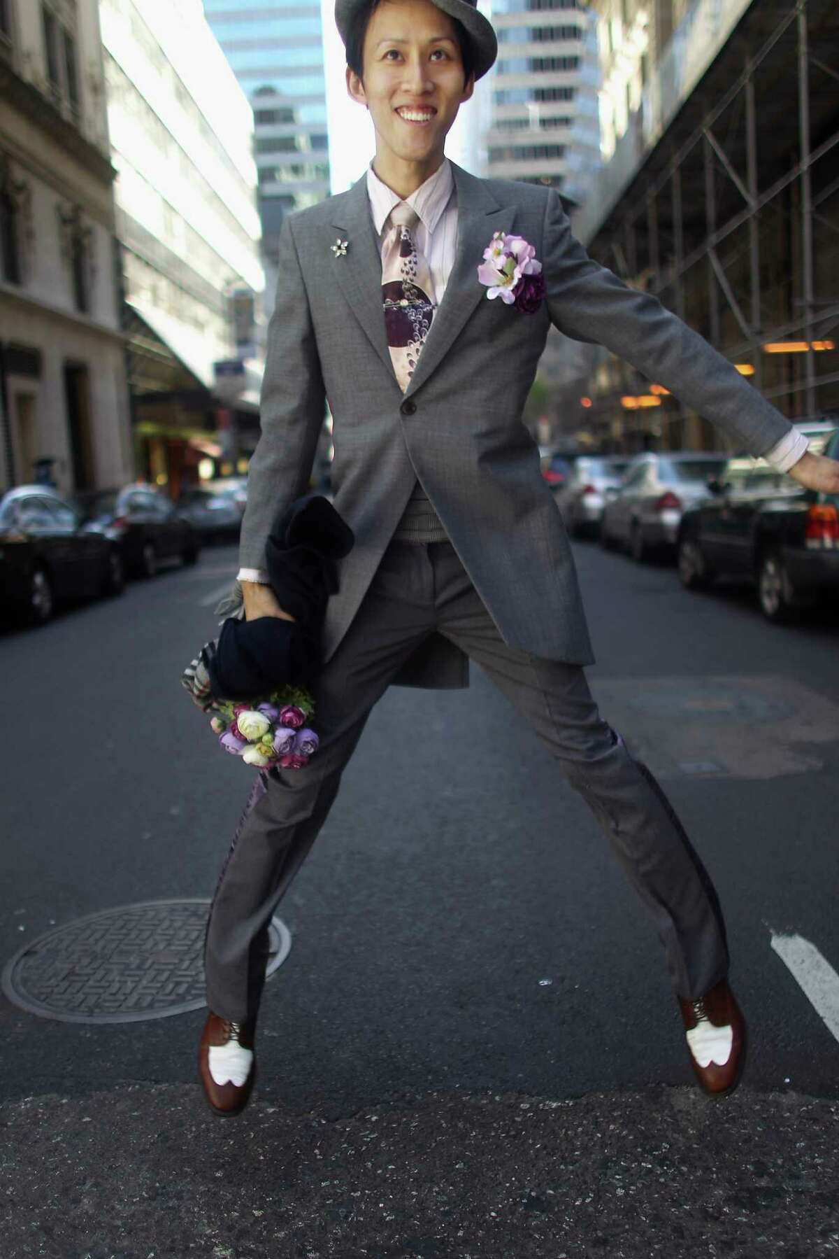 NEW YORK, NY - APRIL 08: Voon Chew jumps while posing in his holiday finery during the annual Easter Parade on April 8, 2012 in New York City. The parade is a New York tradition dating back to the mid-1800s when the social elite would parade their new fashions down Fifth Avenue after attending Easter services in one of the Fifth Avenue churches.