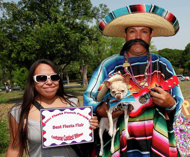 Mariah Cantu and Ernest Vallejo with Conchito attended the 2011 Fiesta Pooch Parade at the Alamo Hei