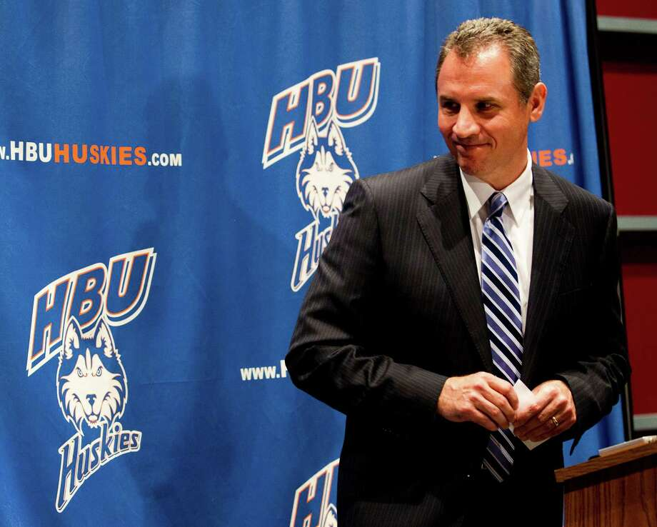 Vic Shealy smiles as he is introduced as the first head football coach at Houston Baptist University Monday, April 9, 2012, in Houston. Shealy,50, comes to HBU from the University of Kansas where he was the defensive coordinator. Photo: Brett Coomer, Houston Chronicle / © 2012 Houston Chronicle