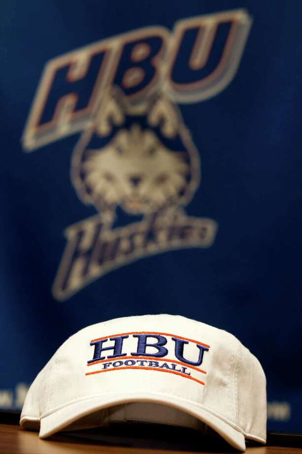 A Houston Baptist University football cap sits on the podium after Vic Shealy was introduced as the first head football coach at Houston Baptist University Monday, April 9, 2012, in Houston. Shealy,50, comes to HBU from the University of Kansas where he was the defensive coordinator. Photo: Brett Coomer, Houston Chronicle / © 2012 Houston Chronicle