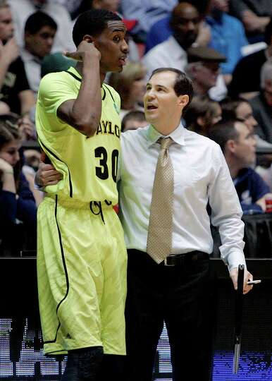 FILE - In this March 17, 2012 file photo, Baylor coach Scott Drew, right, talks with forward Quincy