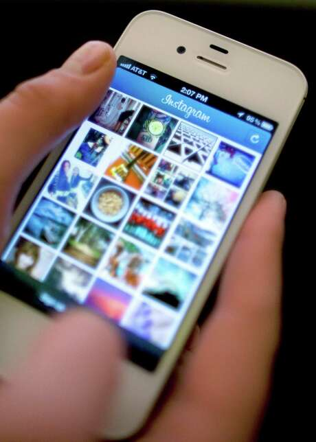 Instagram lets people apply filters to photos they snap with their mobile devices and share them with friends and strangers. Girls with low self-esteem often compare themselves unfavorably to photos they see on social media. Photo: AP