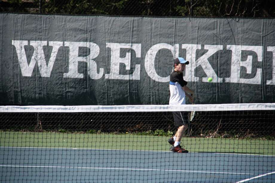 Staples' Baxter Stein returns it during practice. Stein is expected to contribute in either singles or doubles this spring. Photo: Justine Seligson / For The Westp