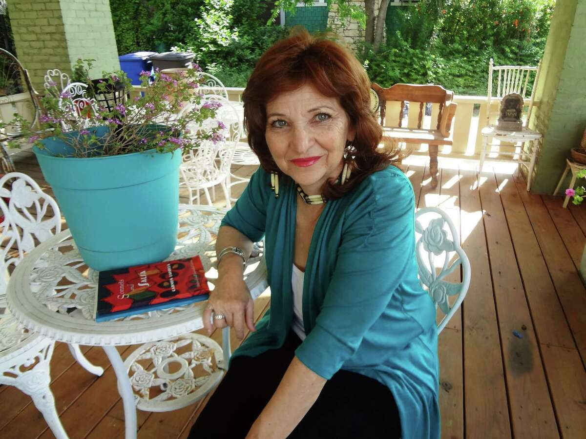 San Antonio's first poet laureate Carmen Tafolla on her front porch.